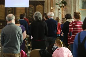 People worshipping in the church